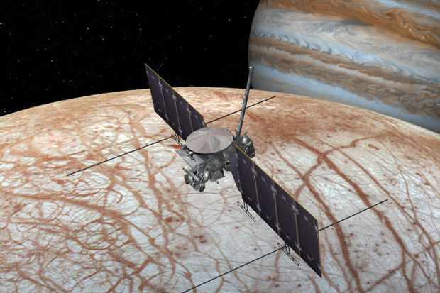 An artist's impression of Europa Clipper in orbit around Jupiter's frozen moon. Credit: NASA/JPL-Caltech
