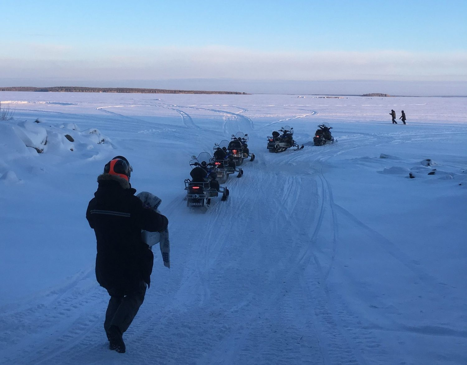 Joining a guided snowmobile tour over the frozen sea. Credit: Chris Bramley