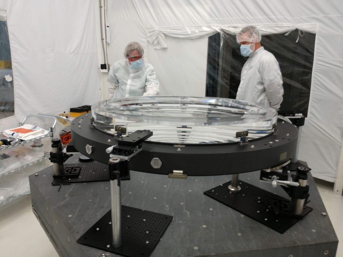 In June 2018 the L2 lens for the LSST Camera was attached to the pads that will mount to the composite ring of the L1-L2 assembly. Credit: LSST Camera Project