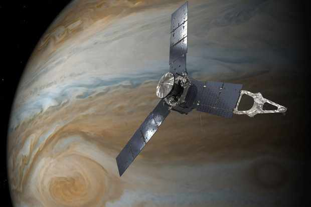 An artist's depiction of the Juno spacecraft in orbit above Jupiter's Great Red Spot. Credit: NASA/JPL-Caltech