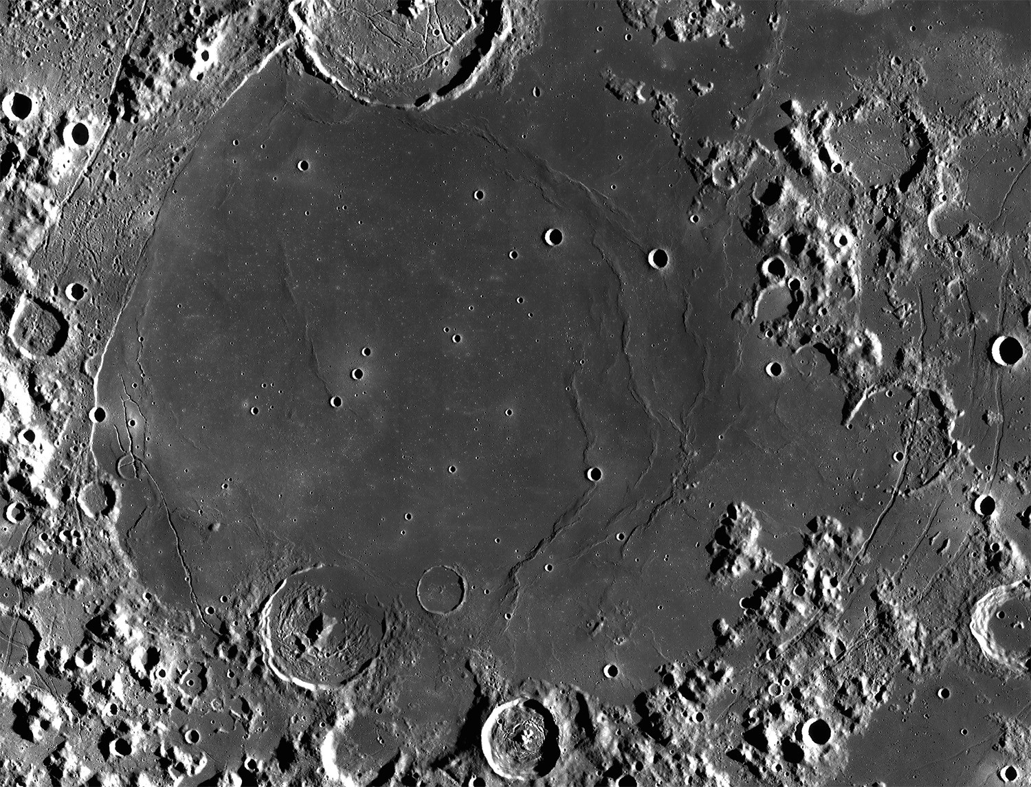 A view of Mare Humorum captured by the Lunar Reconnaissance Orbiter. On the eastern edge can be seen the cracks known as Rimae Hippalus. Credit: NASA (image by Lunar Reconnaissance Orbiter)
