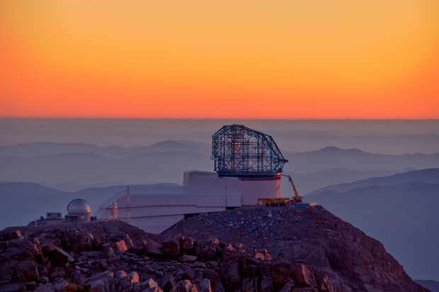 A photo of the Large Synoptic Survey Telescope at sunset, taken from behind the nearby Gemini telescope. Credit: LSST Project/NSF/AURA