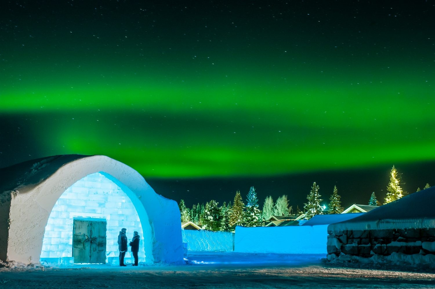 The Northern Lights appear over the ice hotel. Credit: Asaf Kliger