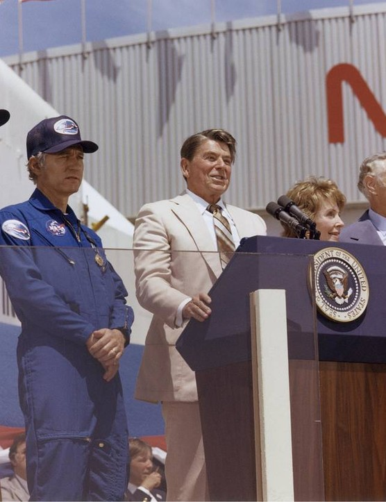 US President Ronald Reagan address a crowd at NASA's Dryden Flight Research Center following the landing of Columbia's STS-4 mission, 4 July 1982. To Reagan's left are STS-4 astronauts Thomas K. Mattingly and Henry W. Hartsfield. Credit: NASA