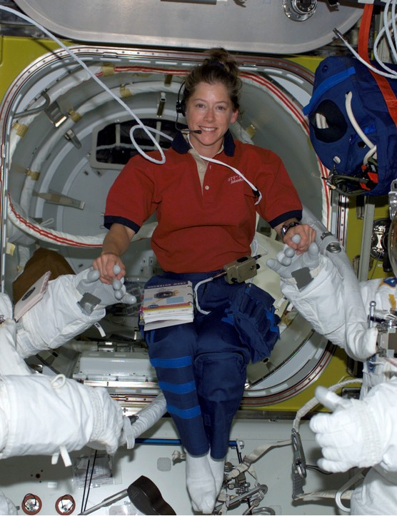 STS-112 pilot Pamela A. Melroy (centre) with Piers J. Sellers (left) and David A. Wolf, preparing for the first spacewalk of the mission, October 2002, which saw Melroy become the second woman to command a Space Shuttle. Credit: NASA.