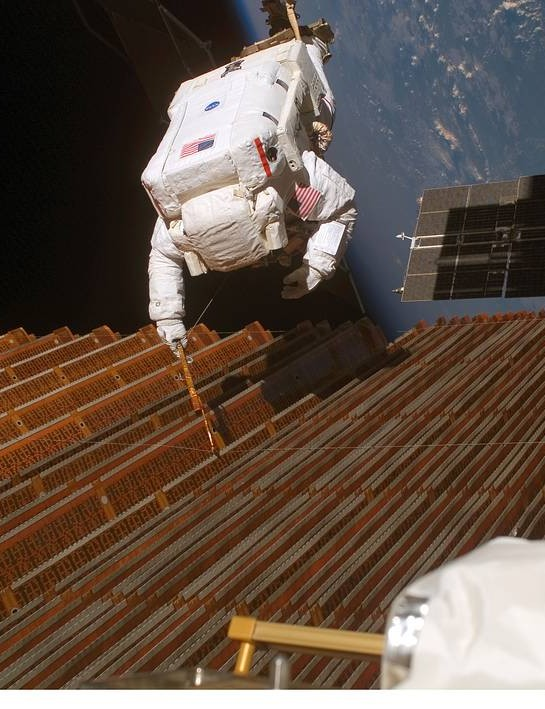Robert Curbeam works on a solar array wing on the International Space Station during mission STS-116, December 2006. Credit: NASA