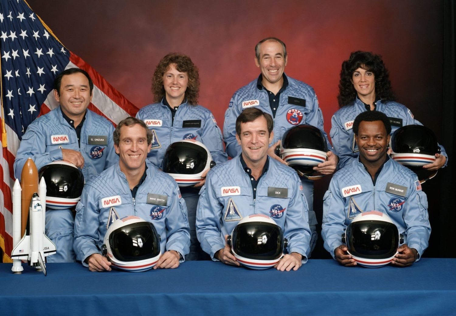 The crew of the ill-fated Challenger mission. Left to right are in the back row: Ellison S. Onizuka, Sharon Christa McAuliffe, Greg Jarvis, Judy Resnik. Left to right in the front row: Mike Smith, Dick Scobee, Ron McNair. Credit: NASA