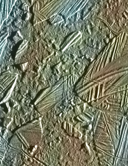 Galileo's view of a thin ice crust in the Conamara region of the moon Europa. White and blue regions are areas covered in fine ice particles. Credit: NASA/JPL/University of Arizona