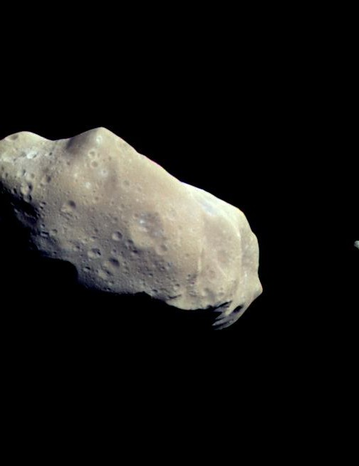 Galileo's image of asteroid Ida and its moon Dactyl: the first satellite ever discovered around an astroid. This image was captured 14 minutes before Galileo's closest approach on 28 August 1993. Credit: NASA/JPL