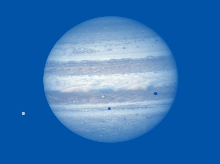 See Jupiter's moons cast their shadow on the gas giant