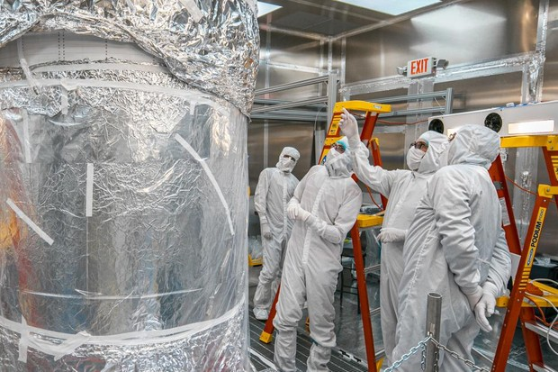 Scientists inspect the newly-assembled LUX-ZEPLIN experiment at the Surface Assembly Lab cleanroom, Sanford Underground Research Facility. Credit: Matthew Kapust, Sanford Underground Research Facility.