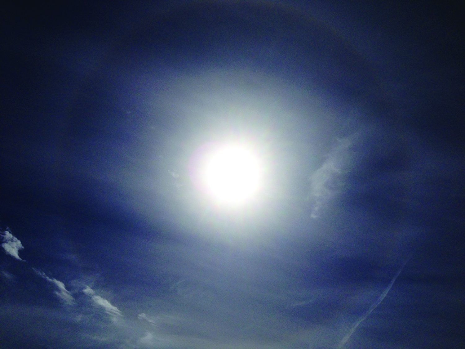 Also watch out for solar haloes, appearing as rings around the Sun; they're caused by ice particles refracting light. Credit: Pete Lawrence