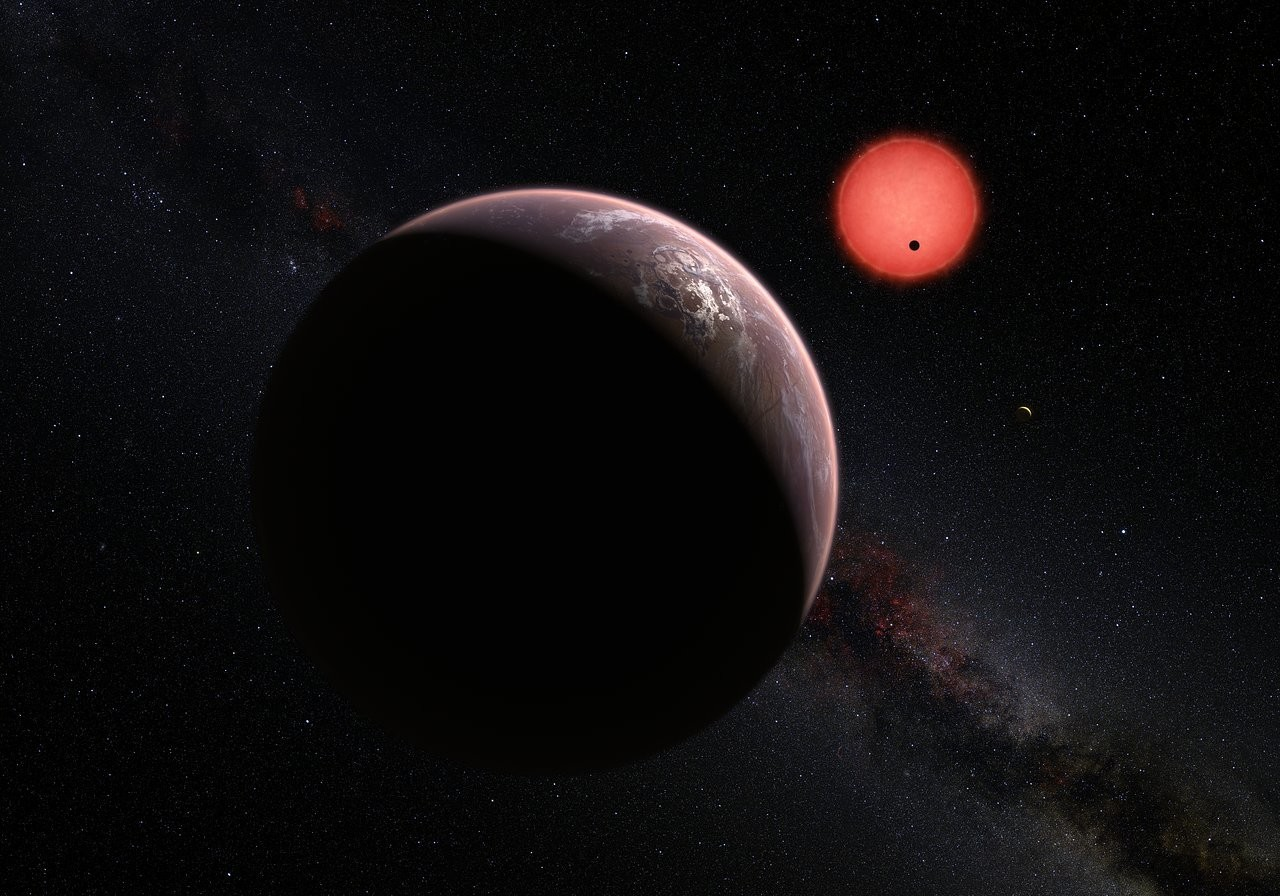 An artist's impression showing an imagined view of the exoplanets within the TRAPPIST-1 system, 40 lightyears from Earth. Credit: NASA