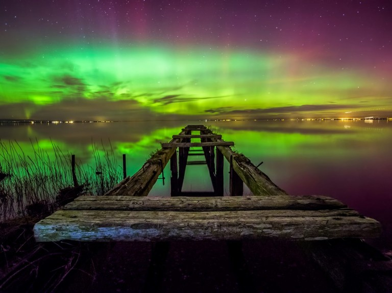 What causes the different shapes and colours of the aurora?