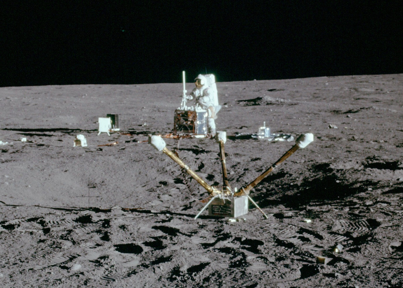 Commander Conrad sets up the Apollo Lunar Surface Experiments Package (ALSEP) during the first EVA. Credit: NASA