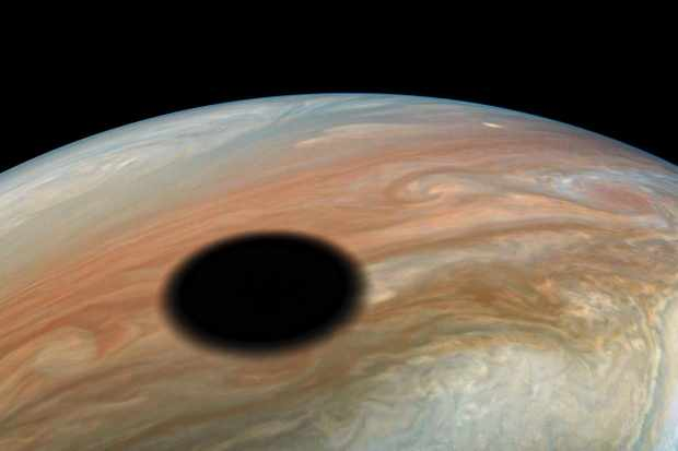 The shadow of moon Io projected onto Jupiter. Image credit: Image data: NASA/JPL-Caltech/SwRI/MSSS Image processing by Kevin M. Gill, CC BY 3.0