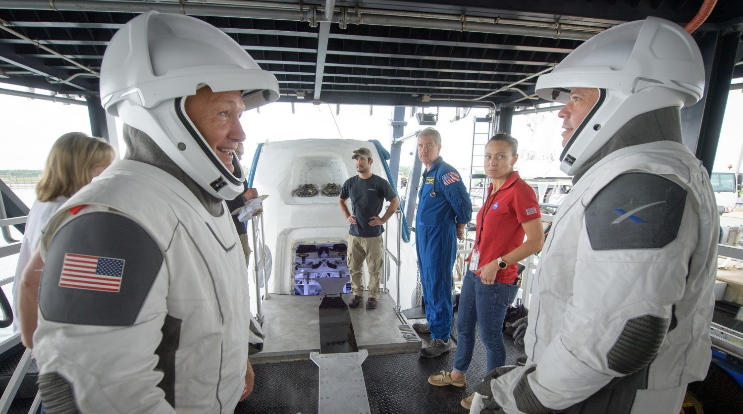 NASA astronauts Doug Hurley (left) and Bob Behnken during crew extraction rehearsals from the SpaceX Crew Dragon, 13 August 2019 at Cape Canaveral, Florida. Credit: (NASA/Bill Ingalls)