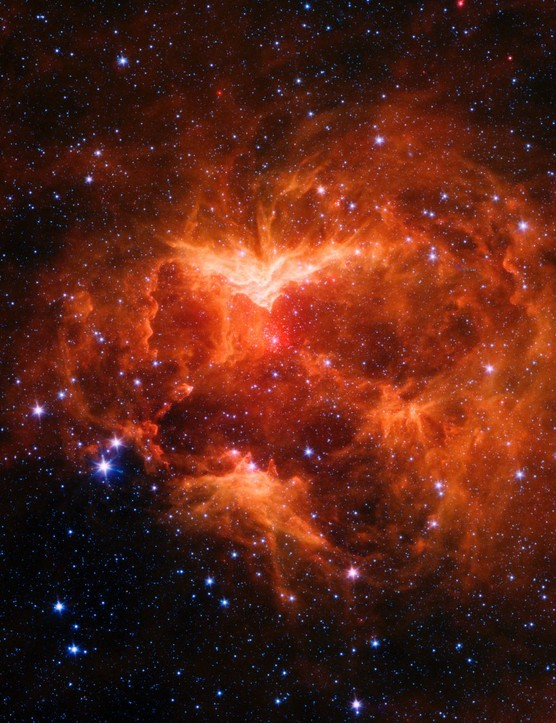 Jack-o'-Lantern Nebula This nebula features powerful outflows of radiation and particles from a star 15-20 times more massive than our Sun. Credit:NASA/JPL-Caltech