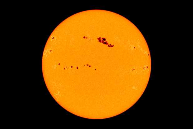 The Sun shows us how sunspots appear dark against a star. Credit: SOHO (ESA & NASA)