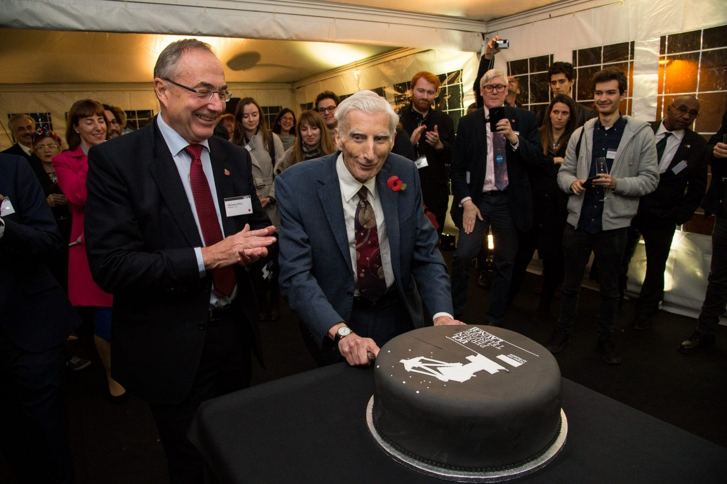Astronomer Royal Martin Rees cuts the cake at the UCL Observatory Perren telescope unveiling event (Image by Kirsten Holst)