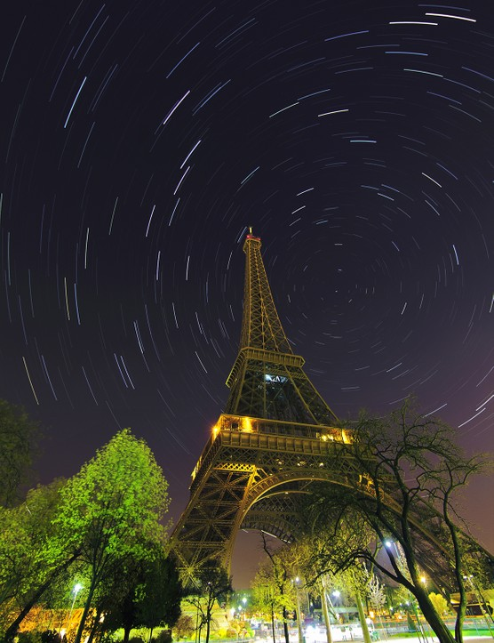 A time-exposure image has captured star trails around the north celestail pole, marked by star Polaris, above Eiffel Tower in paris. The image is made in early morning when the lights of Eiffel is turned off as well as most of touristic monuments in the city. Credit: Babak Tafreshi, TWAN