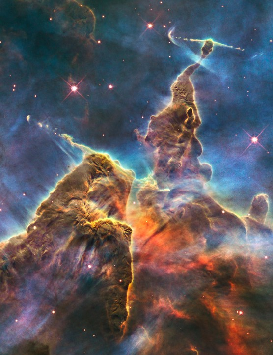 Carina Nebula 23 April 2010. Hubble captures the turbulent cosmic pinnacle within a tempestuous stellar nursery called the Carina Nebula. Stacks of gas and dust, 'Pillars of Creation', are three lightyears tall. Credit: NASA, ESA, M. Livio Hubble 20th Anniversary Team (STScI)