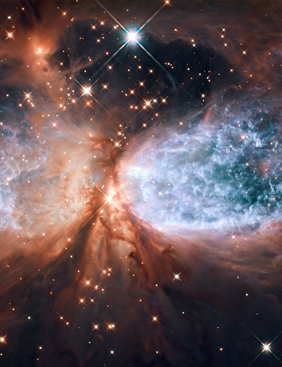 Sh 2-106 15 December 2011. A compact star-forming region in the constellation Cygnus. Newly-formed star S106 IR is shrouded in dust at the centre. Credit: NASA & ESA