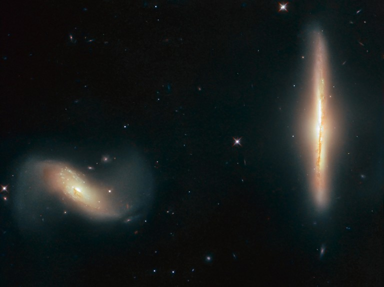 Two spiral galaxies captured by the Hubble Space Telescope