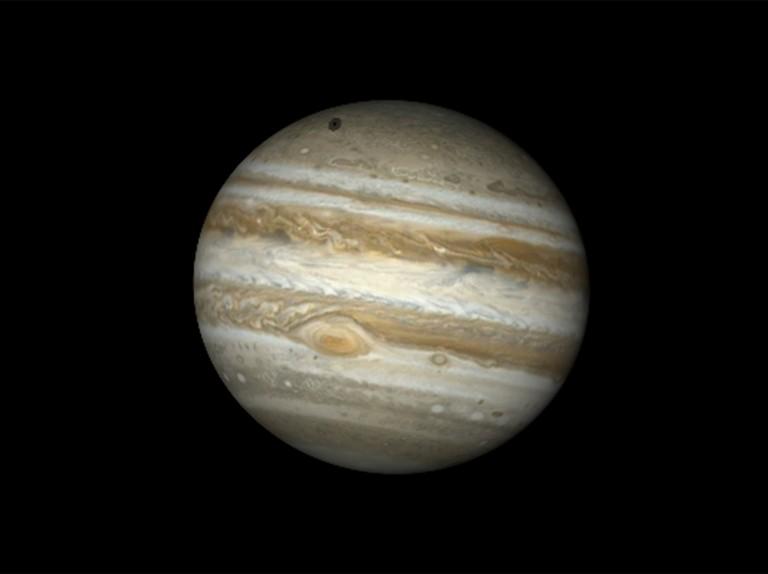 See moon Callisto cast a shadow on Jupiter