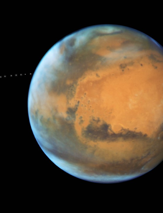 A Hubble Space Telescope image of Mars showing the stages of its moon Phobos's orbit. Credit: NASA, ESA and Z. Levay (STScI) Acknowledgment: J. Bell (ASU) and M. Wolff (Space Science Institute)