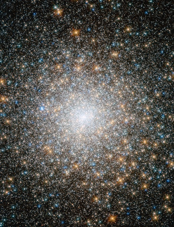 Located in the constellation of Pegasus, 35,000 lightyears away, M15 is one of the oldest-known globular clusters – dating back 12 billion years. Hubble captured the swarming hot blue and cooler golden stars that become more concentrated towards M15's bright core. Credit: ESA, Hubble, NASA
