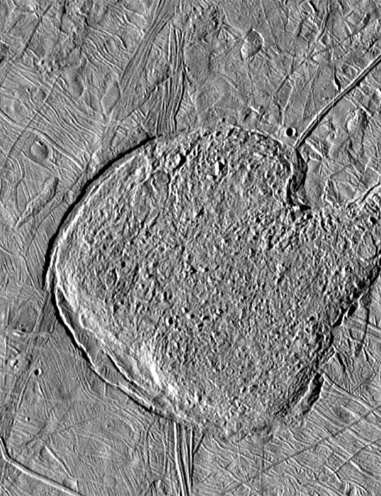 Material in this oddly-shaped region on Jupiter's moon Europa has the appearance of frozen slush, and could be caused by the up-swelling of icy lava from a subsurface liquid ocean. Credit: NASA/JPL