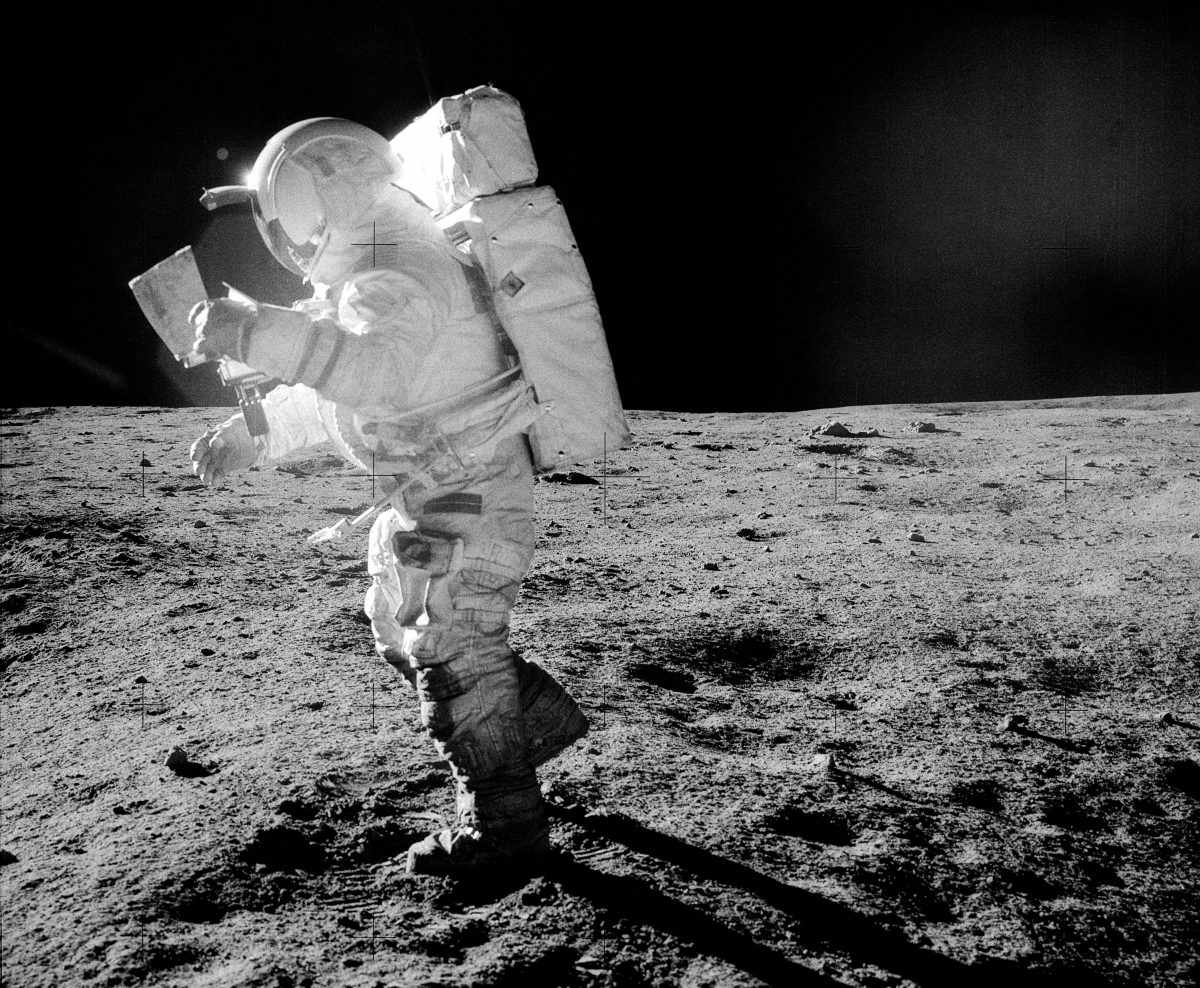 Astronaut Edgar Mitchell on the surface of the Moon during Apollo 14. Mitchell is seen studying a traverse map during exploration of Fra Mauro. Note the lunar dust clinging to Mitchell's boots and legs. Credit: NASA/Alan Shepard