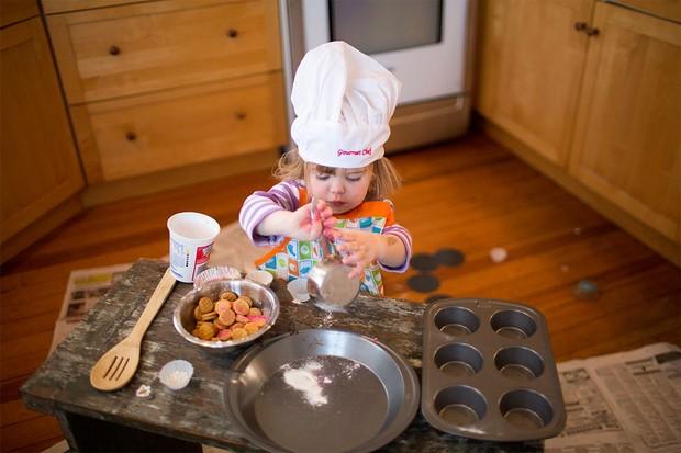 toddler baking in kitchen