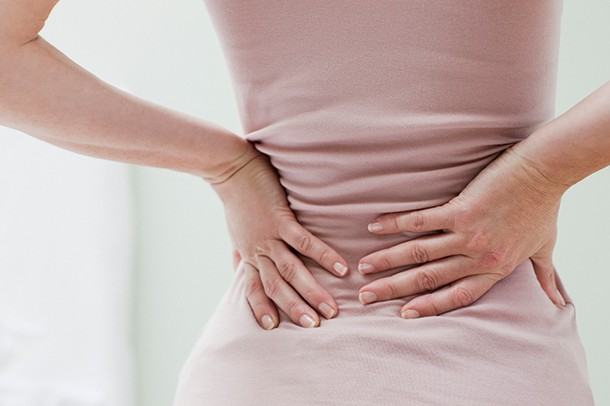 Lower back pain in early pregnancy - what it means | MadeForMum -  MadeForMums