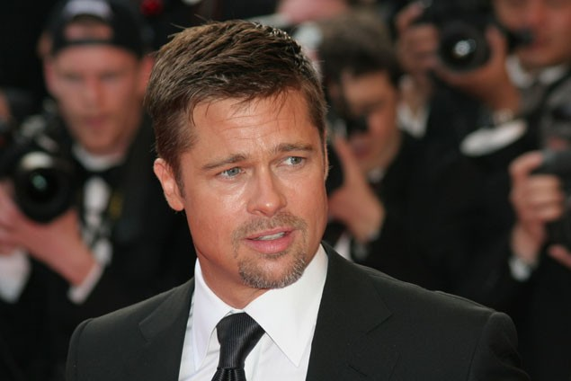 brad-pitt-reveals-why-he-and-angelina-jolie-sold-photos-of-their-newborn-twins_11085
