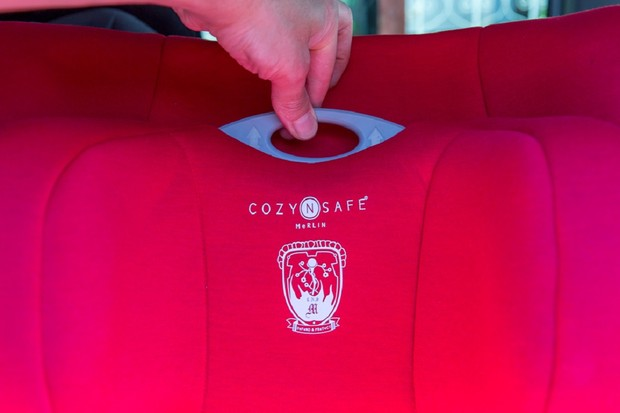Cozy N Safe Merlin has an adjustable headrest