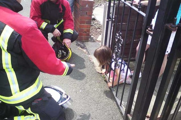 four-year-old-girl-gets-head-stuck-in-gate_23836