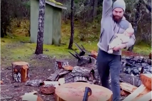 just-why-mans-video-of-himself-chopping-wood-with-a-baby-in-his-arm_149303