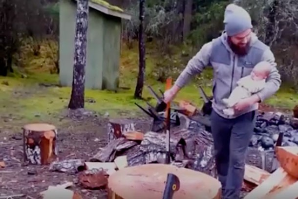 just-why-mans-video-of-himself-chopping-wood-with-a-baby-in-his-arm_149305