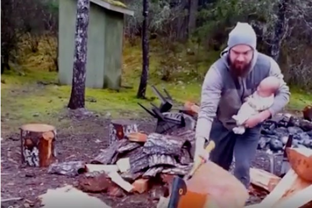 just-why-mans-video-of-himself-chopping-wood-with-a-baby-in-his-arm_149306