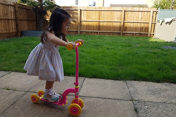 child testing scooter