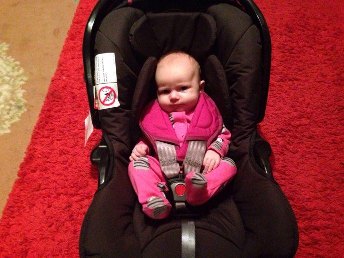a newborn sit in a car seat