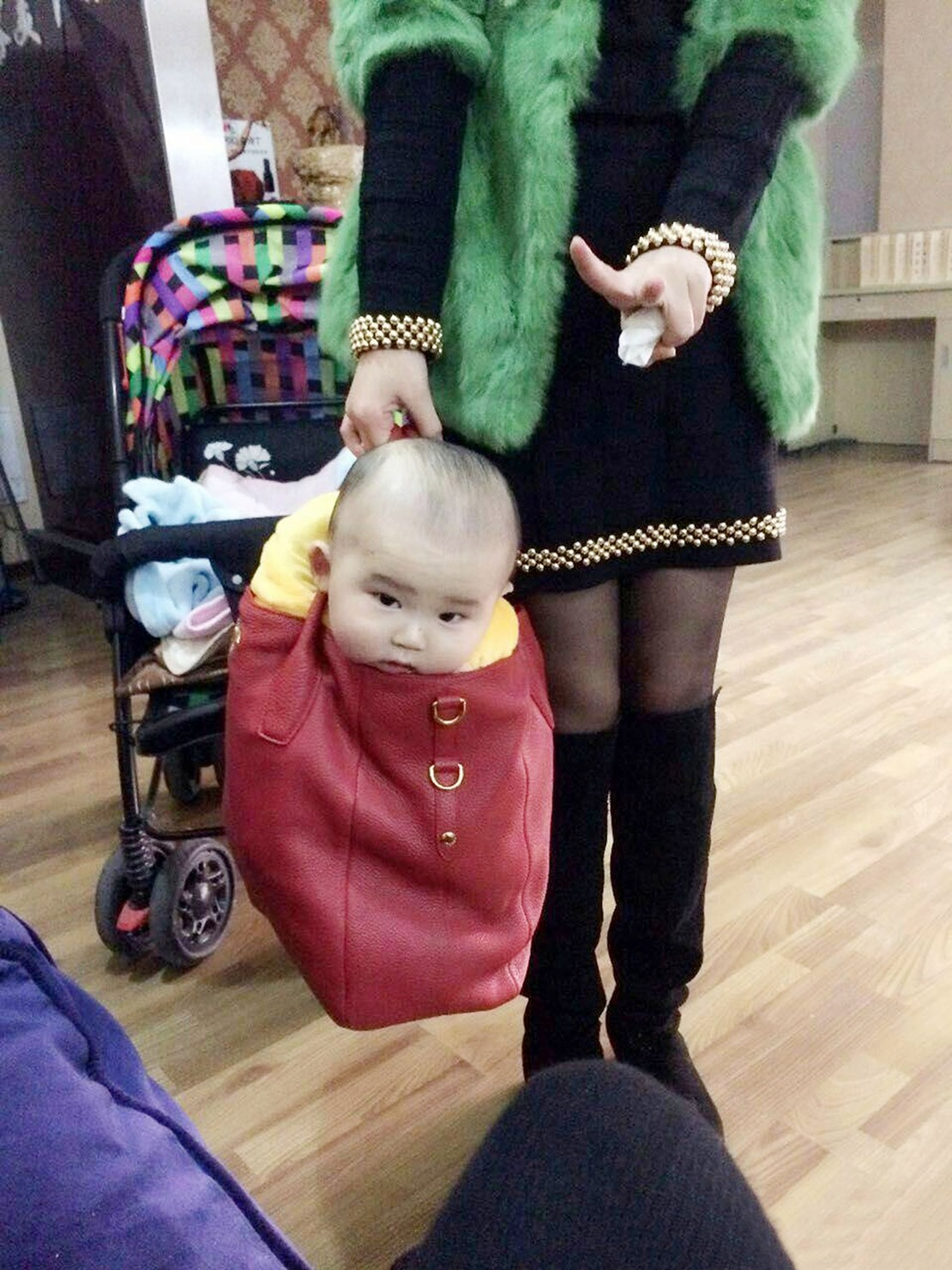 outrage-after-mum-carries-baby-in-handbag_82494