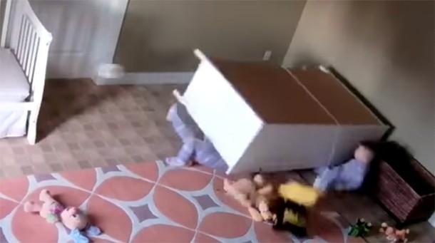 Dresser falls onto twins