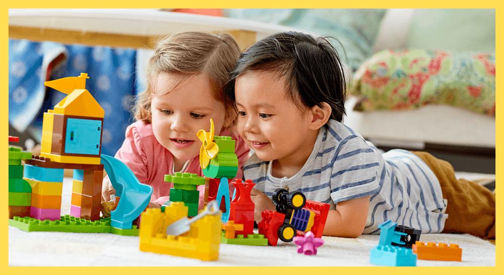 Chlidren playing with Lego duplo prodcusts