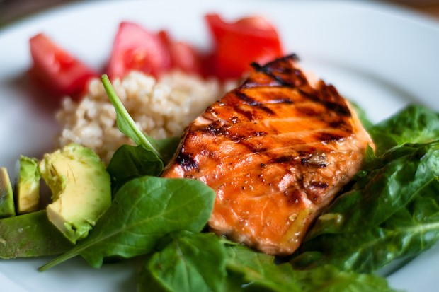 Foods high in iron including salmon, spinach and brown rice