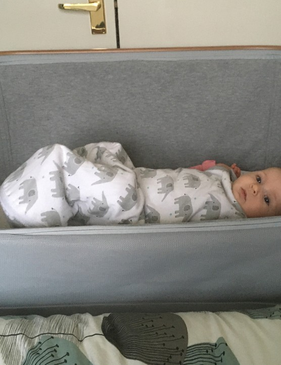 Iora crib connected to bed with baby
