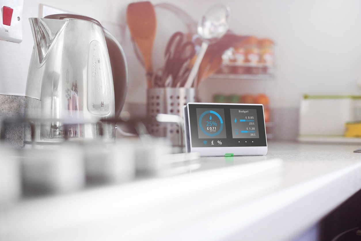 Smart meter in the kitchen of a home showing current energy costs for the day  Design on screen my own. Please see property release.
