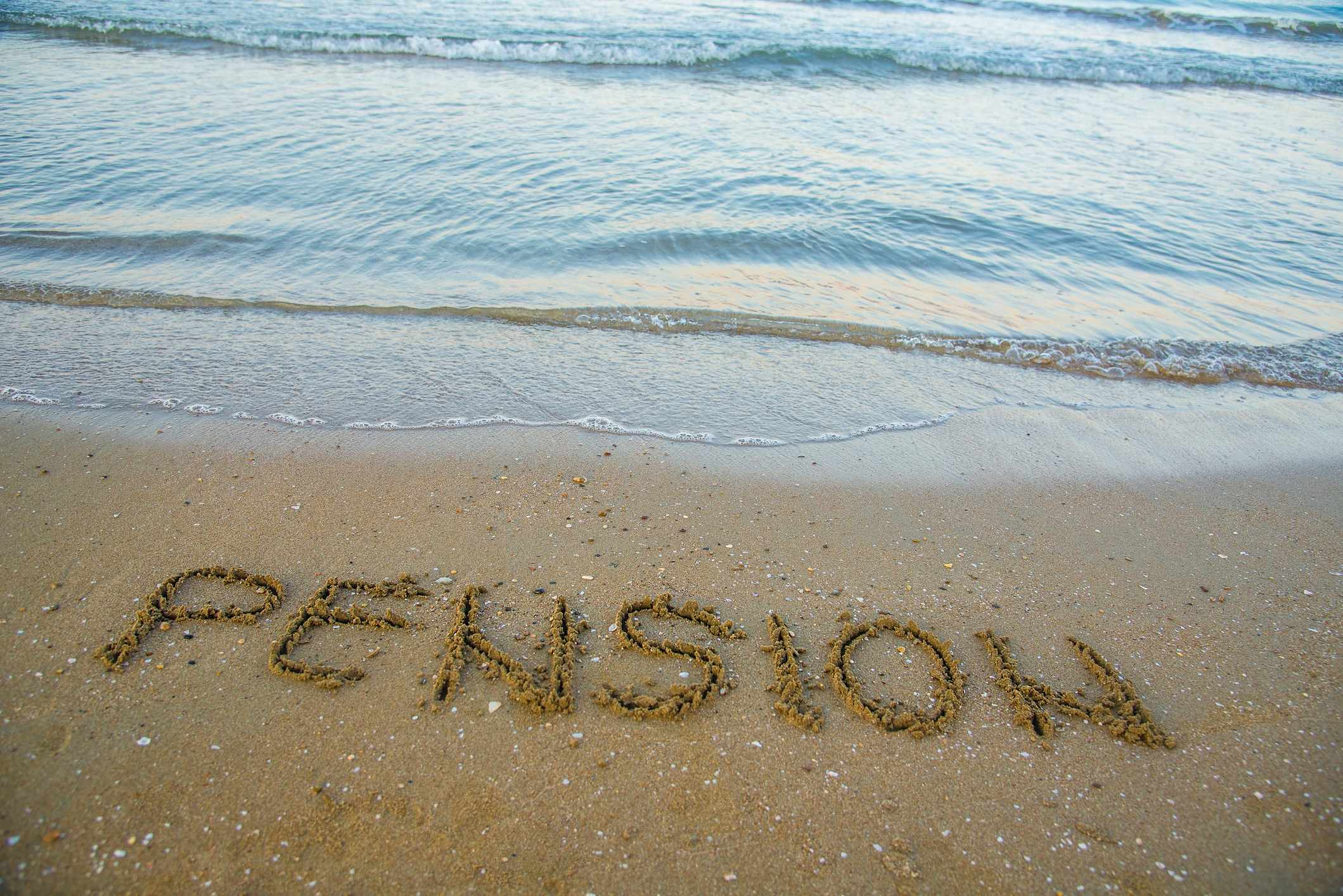 Pension written on sand by sea at beach